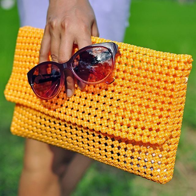 A beautiful handmade clutch by urmiweave made from recycled materialhellip