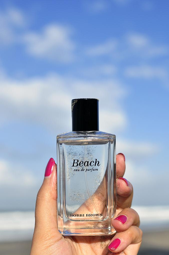 Bali Beauty Guide | Akanksha Redhu | holding beach bottle sky