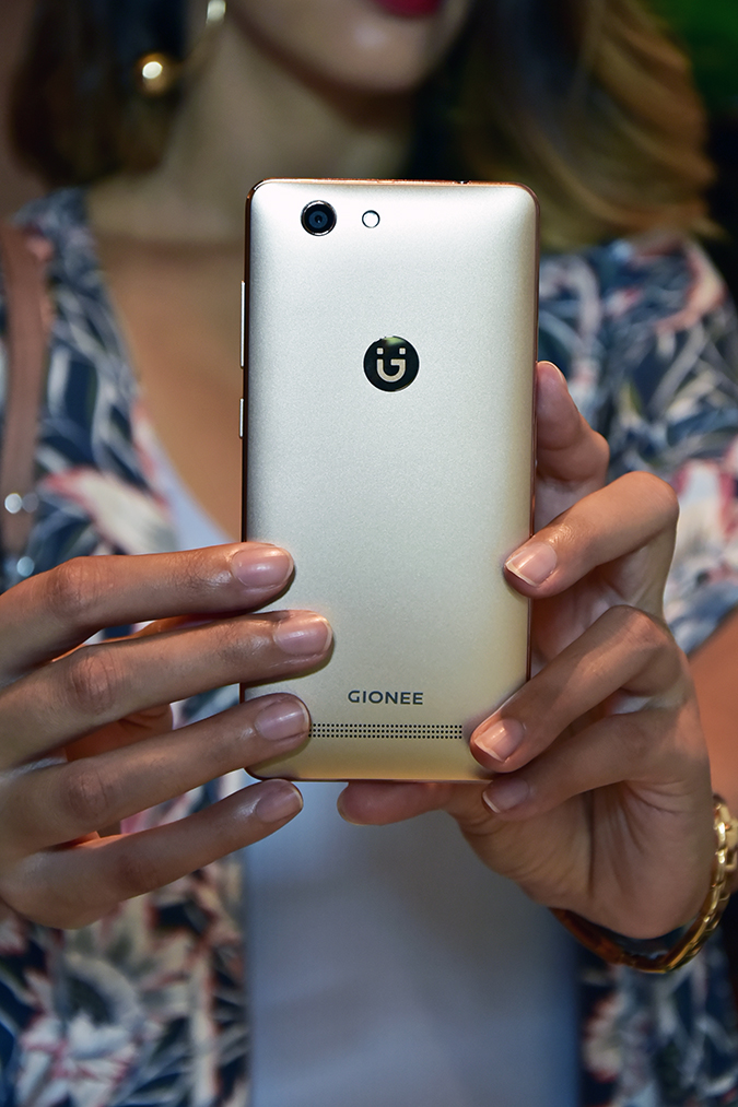 Gionee F103 Pro | Akanksha Redhu | phone in both hands close up