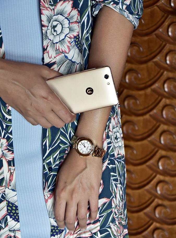 Gionee F103 Pro | Akanksha Redhu | holding phone watch dress