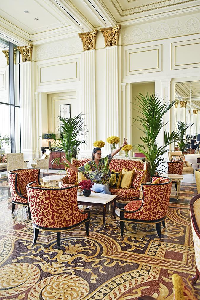 Emirates Holidays | Dubai | Akanksha Redhu | palazzo versace look on sofa