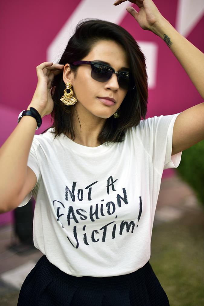#AIFWSS17   Akanksha Redhu   text putting hair behind ear