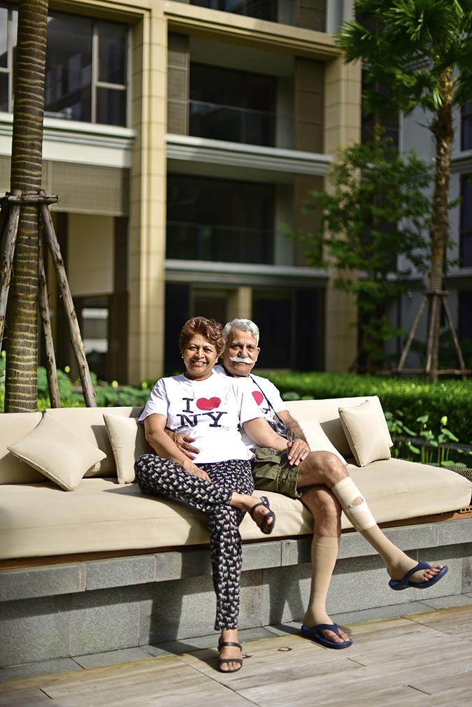 Baan Mai Khao | Phuket | Akanksha Redhu | mom dad matching tee sitting on outdoor couch