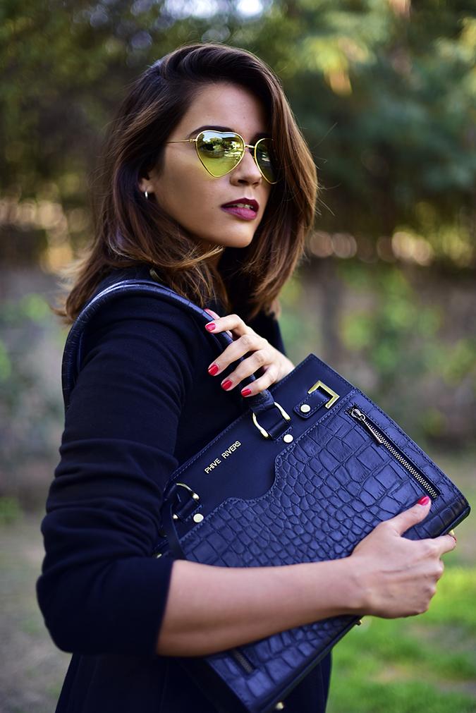 Winter Essentials | Akanksha Redhu | half side cradle bag