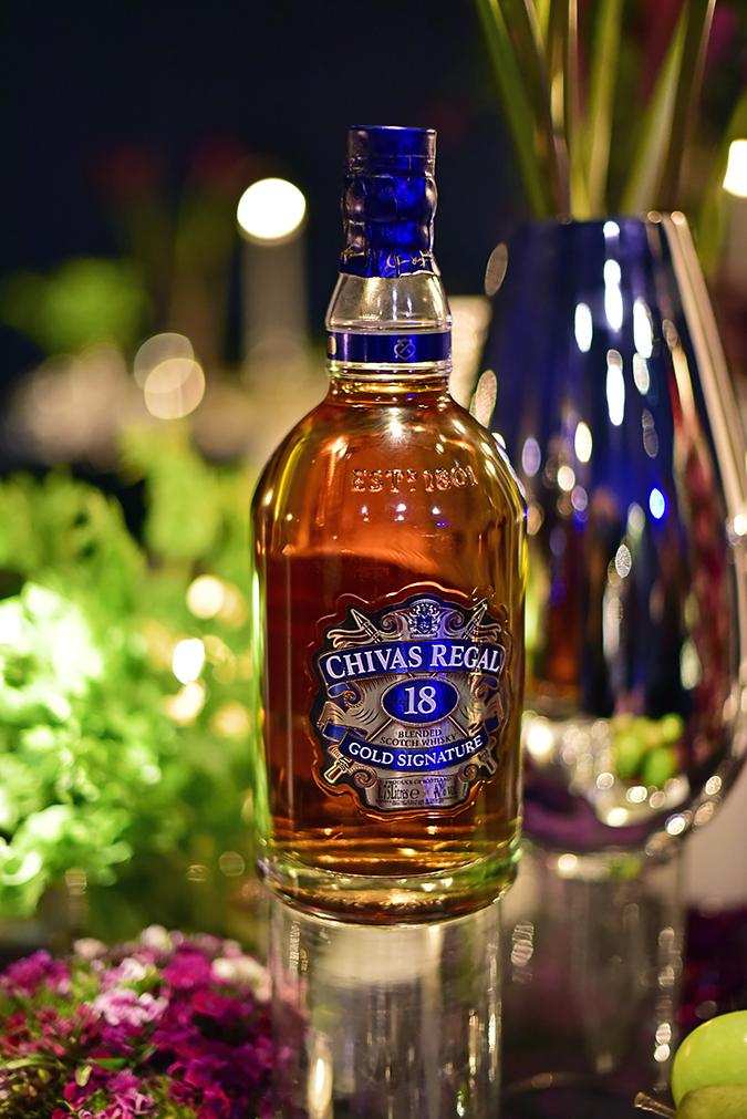 Chivas 18 Alchemy   Akanksha Redhu   chivas bottle kalyani table close up