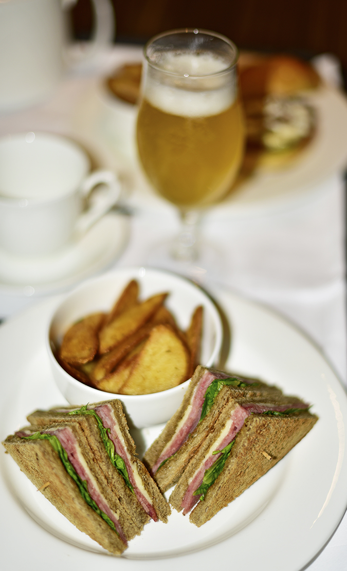 Roseate House   Akanksha Redhu   ham sandwich and beer