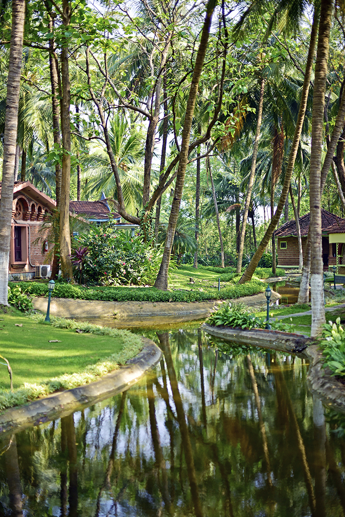 Kairali Ayurvedic Healing Village | Akanksha Redhu | property long from middle of water